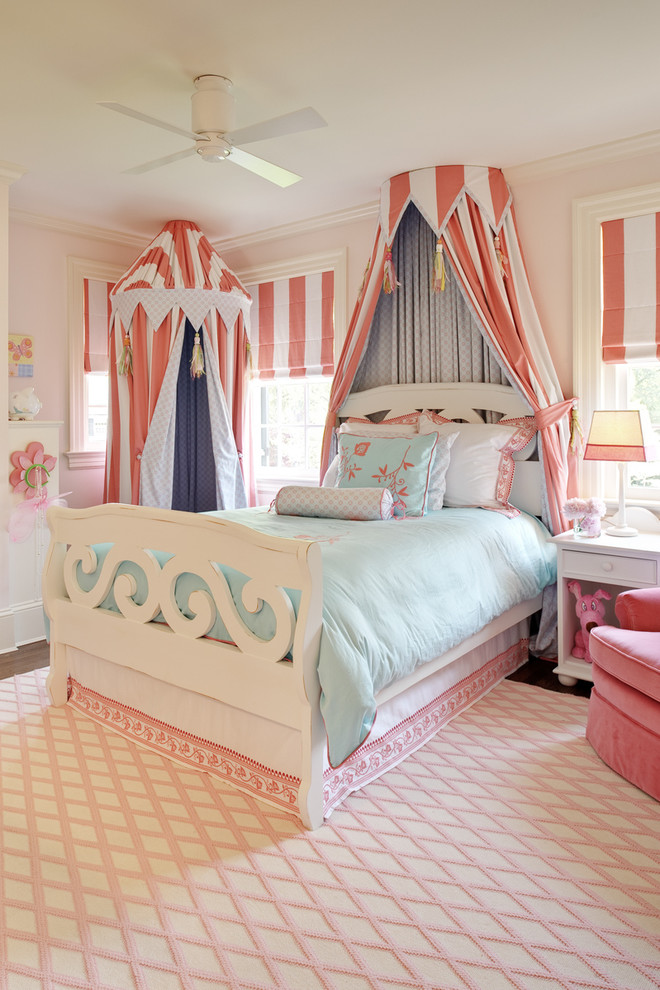 Kids' room - traditional girl dark wood floor kids' room idea in Richmond with pink walls