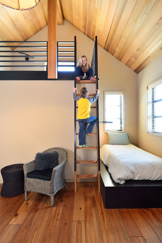 Inspiration for a large contemporary gender-neutral medium tone wood floor kids' bedroom remodel in Boise with white walls