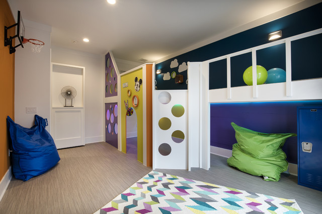 Inspiration for a mid-sized gender-neutral vinyl floor kids' room remodel in Orlando with multicolored walls