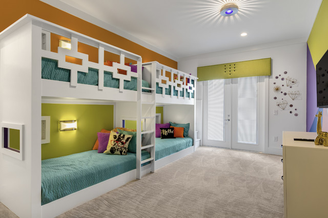 Example of a mid-sized gender-neutral carpeted kids' room design in Orlando with multicolored walls