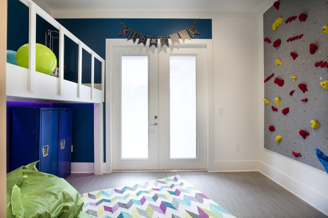 Mid-sized gender-neutral vinyl floor kids' room photo in Orlando with multicolored walls