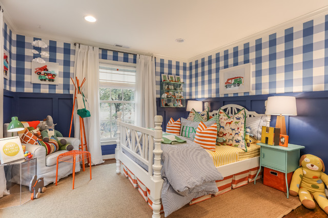 Example of a classic boy dark wood floor kids' room design in Kansas City with multicolored walls
