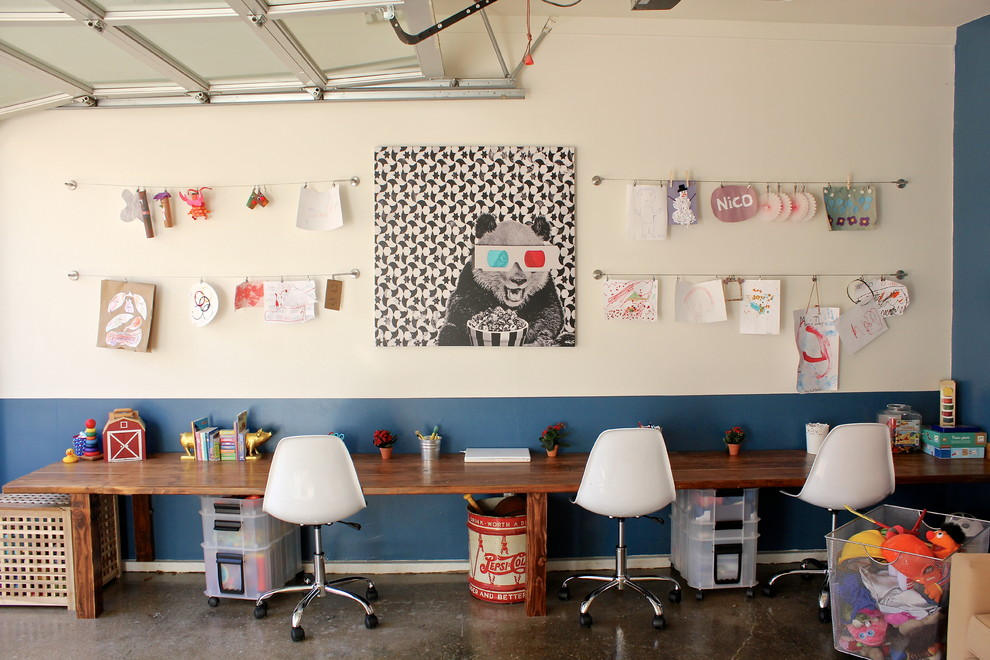 Eclectic gender-neutral concrete floor kids' room photo in Los Angeles with multicolored walls