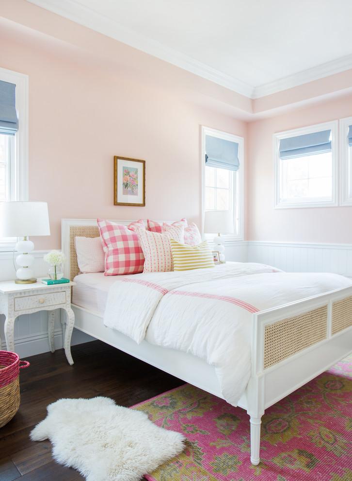 Kids' bedroom - transitional girl dark wood floor kids' bedroom idea in Los Angeles with pink walls