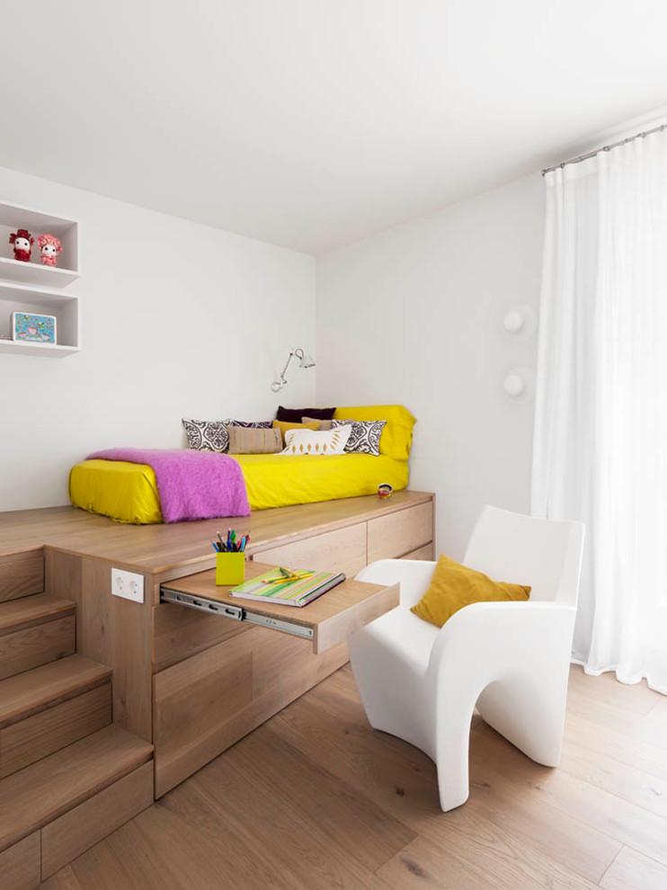 Large trendy gender-neutral medium tone wood floor kids' room photo in Barcelona with white walls