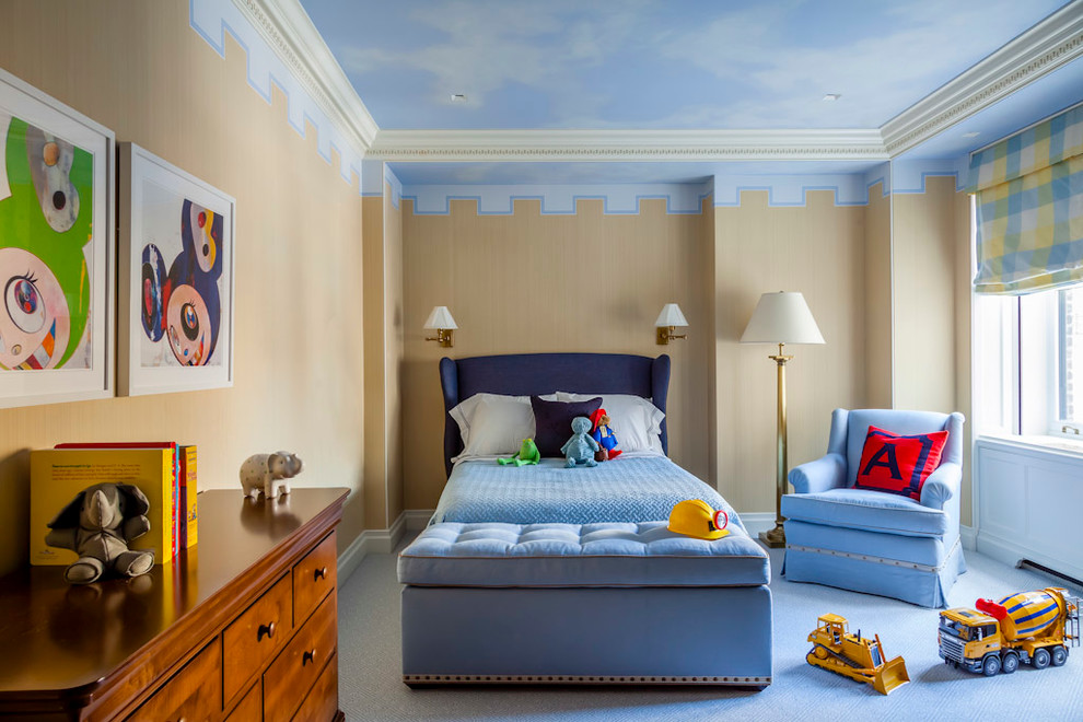 Kids' bedroom - mid-sized traditional boy carpeted and blue floor kids' bedroom idea in New York with beige walls