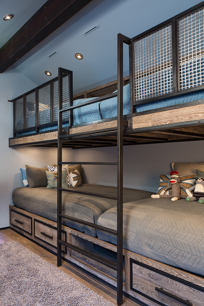 Example of a small mountain style gender-neutral medium tone wood floor kids' room design in Salt Lake City with gray walls