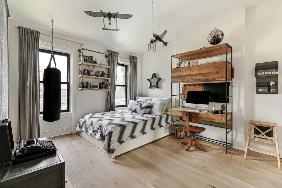 Kids' room - large transitional boy light wood floor and beige floor kids' room idea in New York with white walls