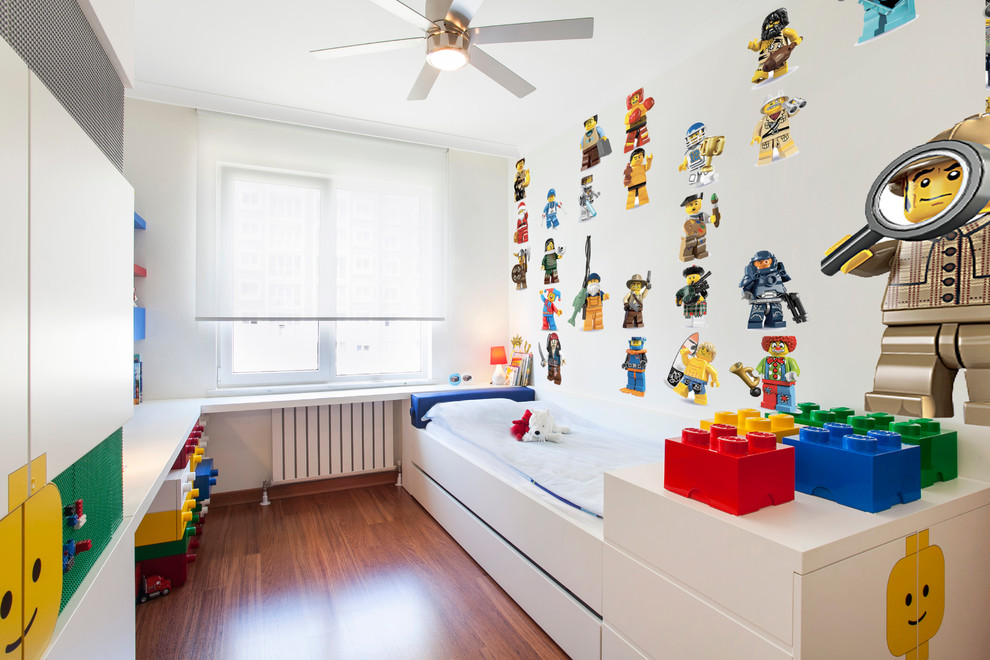 Kids' room - contemporary boy medium tone wood floor kids' room idea in Other with white walls