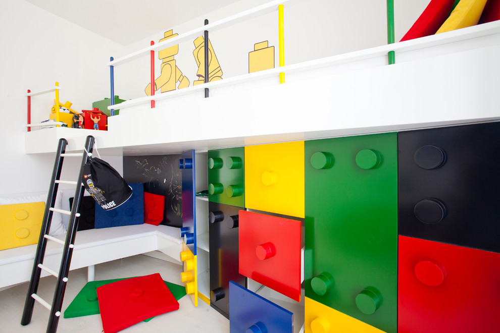 Minimalist boy kids' room photo in Other with white walls