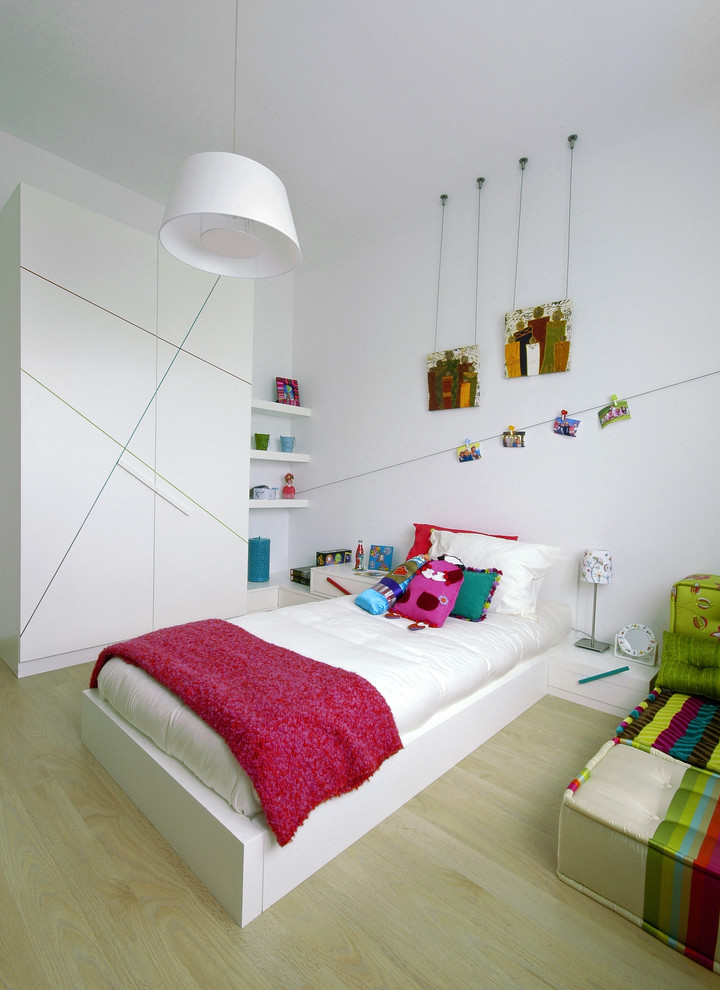Inspiration for a contemporary gender-neutral light wood floor kids' room remodel in Other with white walls