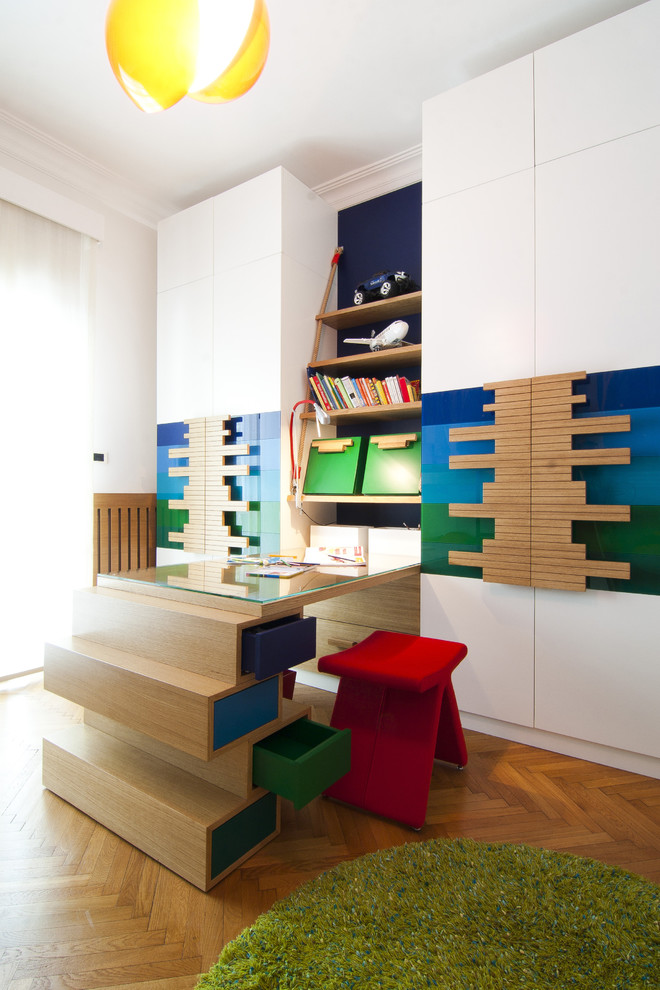 Trendy gender-neutral medium tone wood floor kids' study room photo in Other with white walls