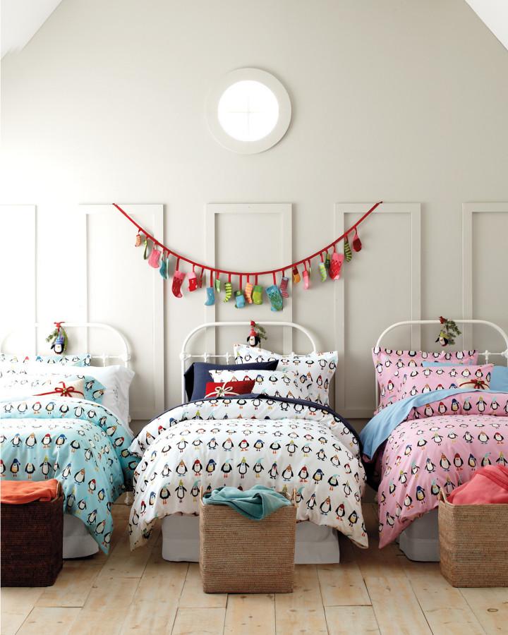 Inspiration for an eclectic gender-neutral light wood floor kids' bedroom remodel in Burlington with white walls