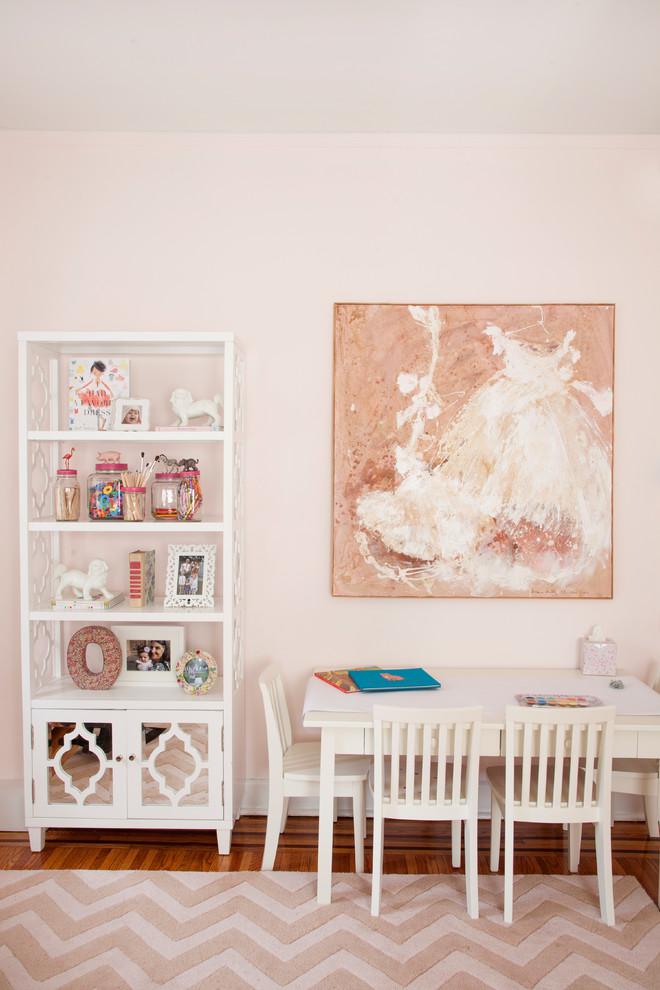 Example of an eclectic girl medium tone wood floor kids' study room design in Philadelphia with pink walls