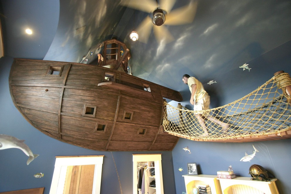Kids' room - eclectic gender-neutral carpeted kids' room idea in Minneapolis with blue walls