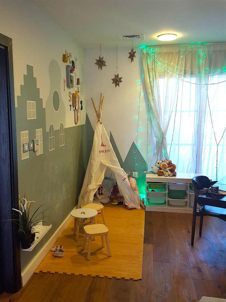 Inspiration for a small modern gender-neutral kids' room remodel in Other with green walls