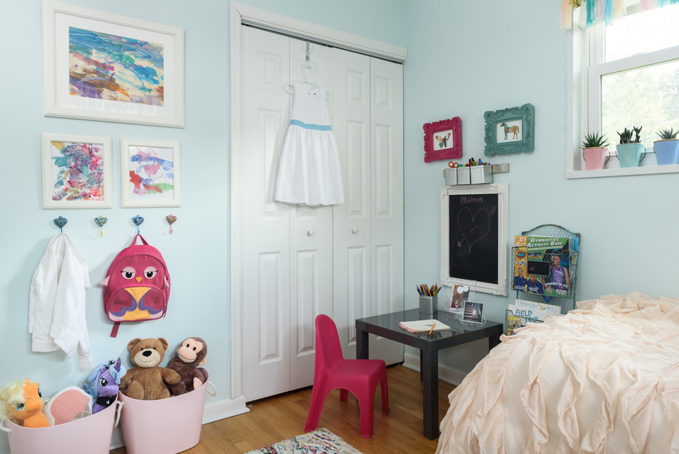 Inspiration for a small timeless girl light wood floor kids' room remodel in DC Metro with blue walls
