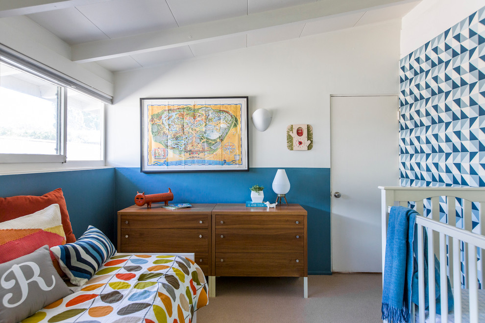 Example of a mid-sized 1960s boy carpeted kids' room design in Los Angeles with multicolored walls