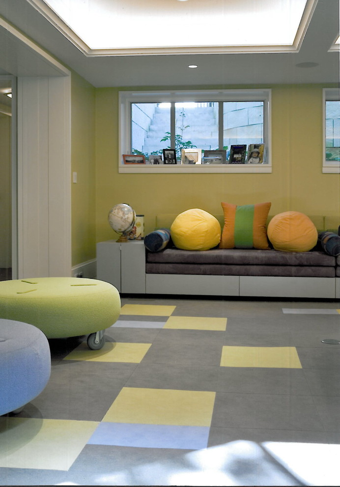 Example of a trendy gender-neutral carpeted and multicolored floor playroom design in Chicago with green walls