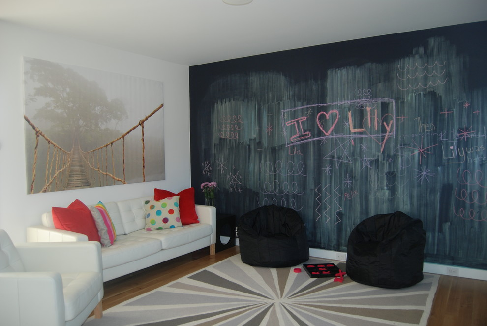 Playroom - mid-sized modern gender-neutral medium tone wood floor playroom idea in Providence with white walls