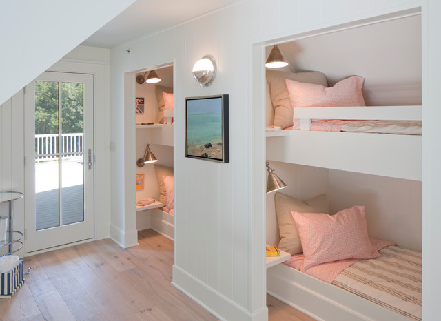 Inspiration for a beach style girl light wood floor kids' room remodel in Grand Rapids with white walls