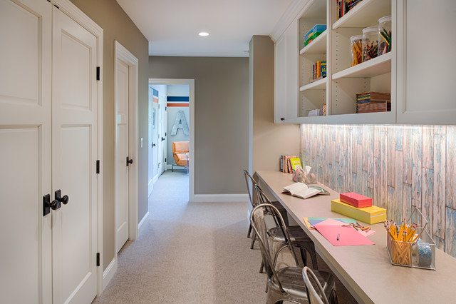Photo of a medium sized classic gender neutral children's room in Minneapolis with grey walls, carpet and grey floors.