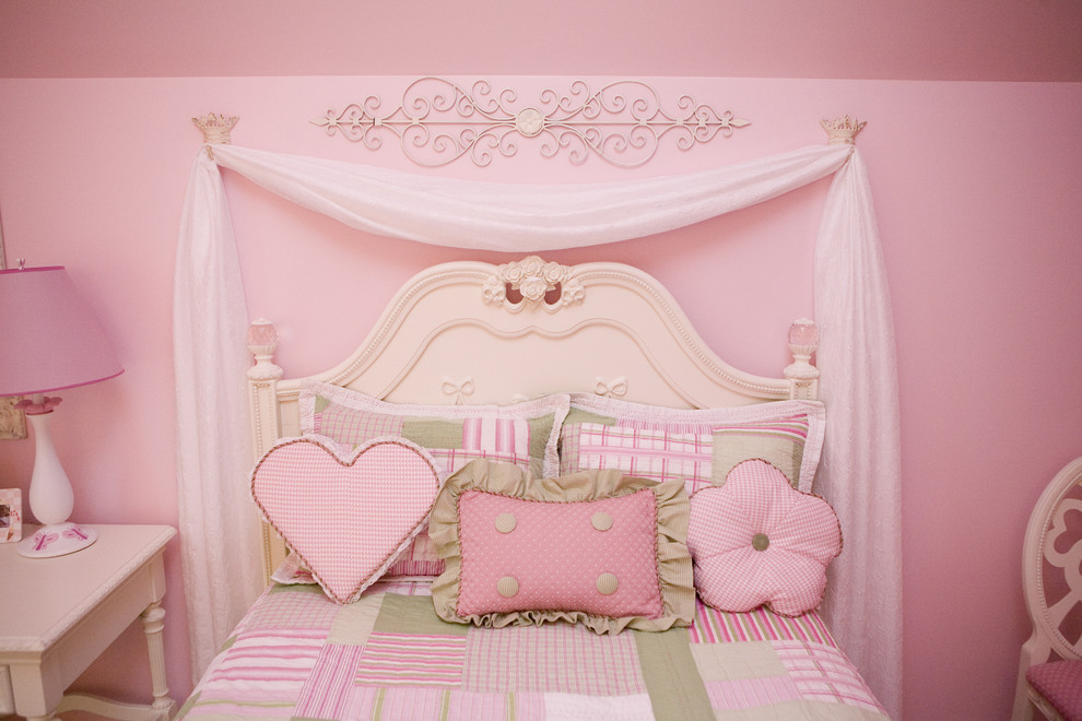 Example of a large classic girl carpeted kids' room design in Other with pink walls