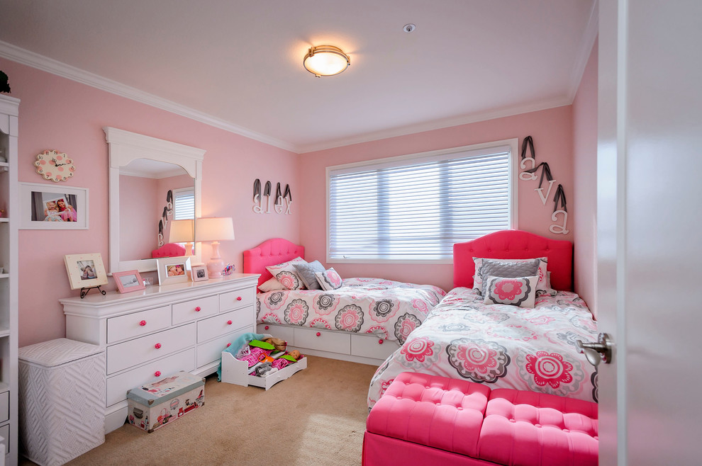 Inspiration for a timeless kids' room remodel in San Francisco with pink walls
