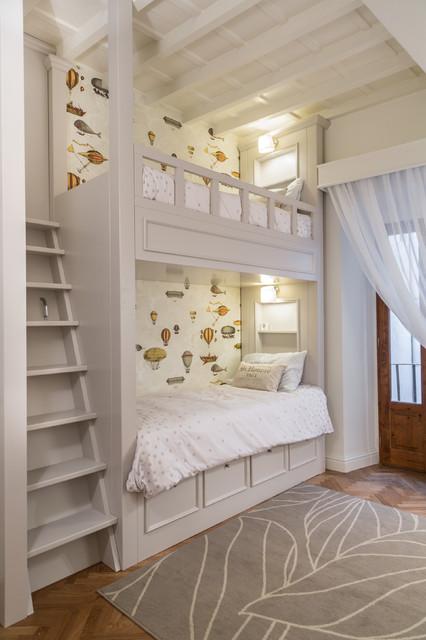 Elegant gender-neutral medium tone wood floor kids' room photo in Florence with white walls