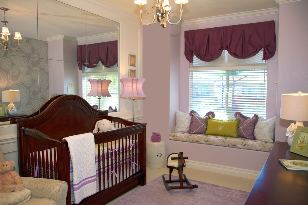 Example of a classic girl carpeted kids' bedroom design in Orange County with purple walls