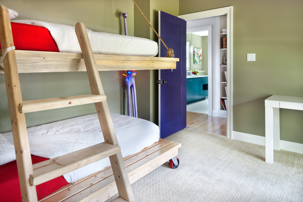 Kids' room - contemporary gender-neutral carpeted kids' room idea in Austin with green walls