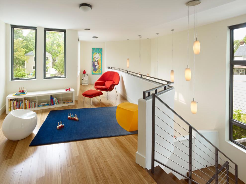 Example of a minimalist gender-neutral light wood floor and beige floor kids' room design in New York with beige walls