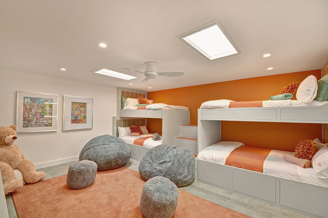 Example of a trendy gender-neutral carpeted kids' bedroom design in Other with multicolored walls