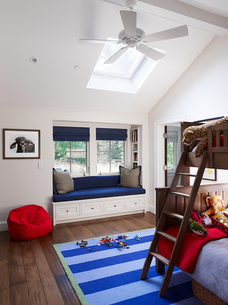 Example of a classic boy dark wood floor kids' room design in San Francisco with white walls