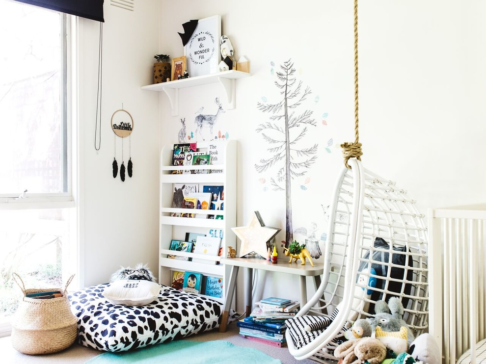 Example of a danish gender-neutral carpeted playroom design in Melbourne with white walls