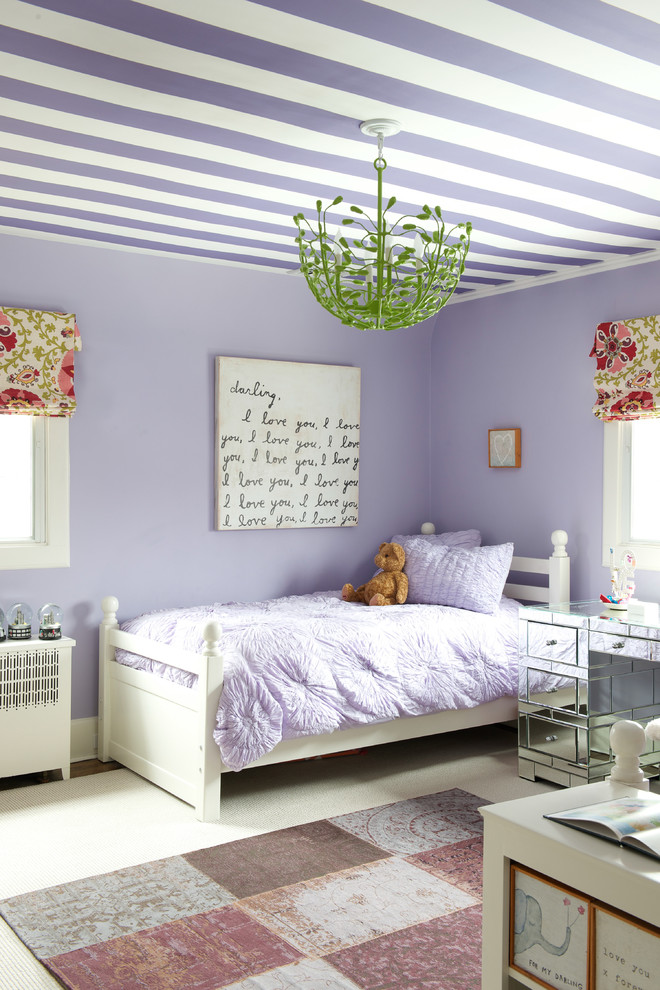 Example of a transitional girl kids' room design in New York with purple walls