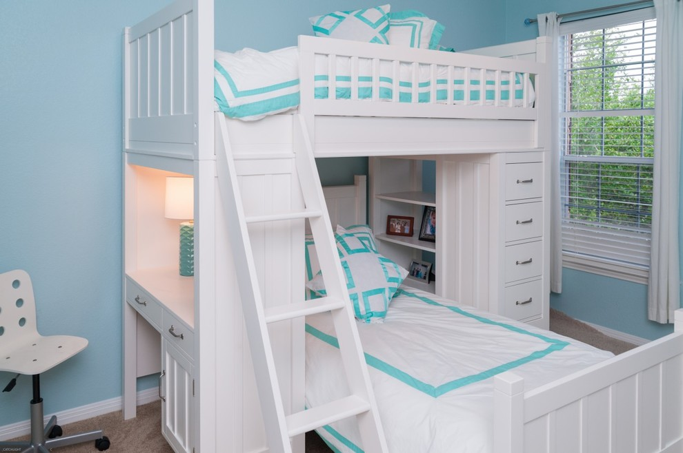 Inspiration for a small transitional girl carpeted and beige floor kids' room remodel in Austin with blue walls