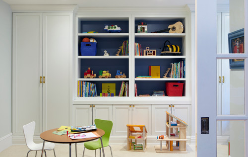 homeschool room or playroom with a table and chairs and shelves and cabinets for storage