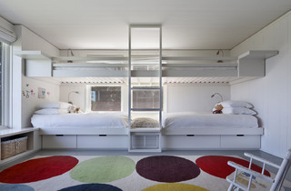 Modern bunk room with direction lights and storage for each of the 4 beds.