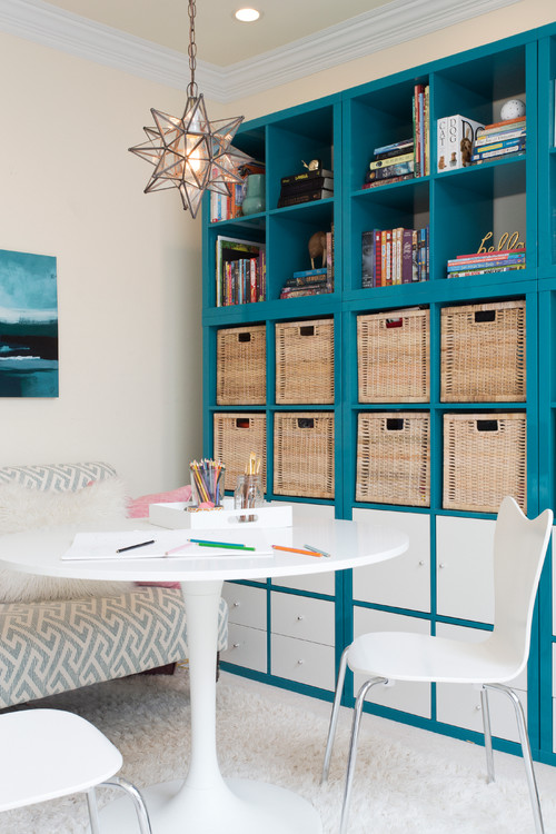 Teal blue built-in cabinets with white modern study table