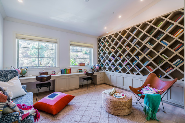 Example of a transitional brown floor kids' study room design in Los Angeles with white walls