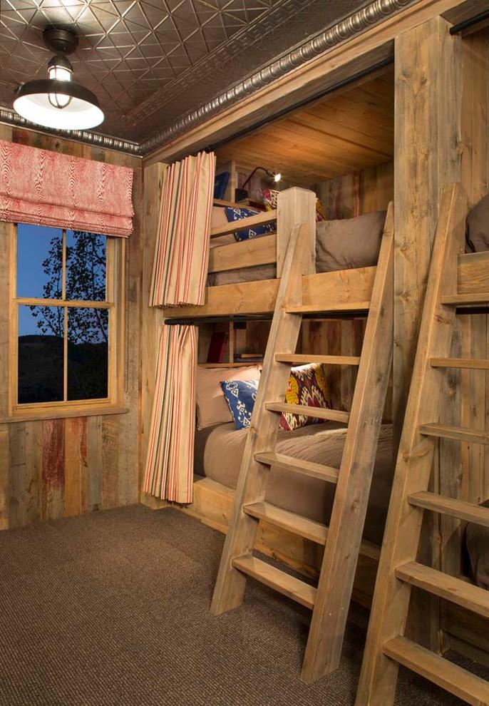 Kids' room - rustic gender-neutral carpeted kids' room idea in Denver