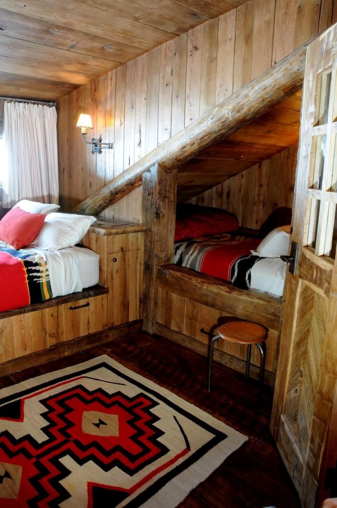 Kids' bedroom - rustic gender-neutral dark wood floor kids' bedroom idea in Atlanta