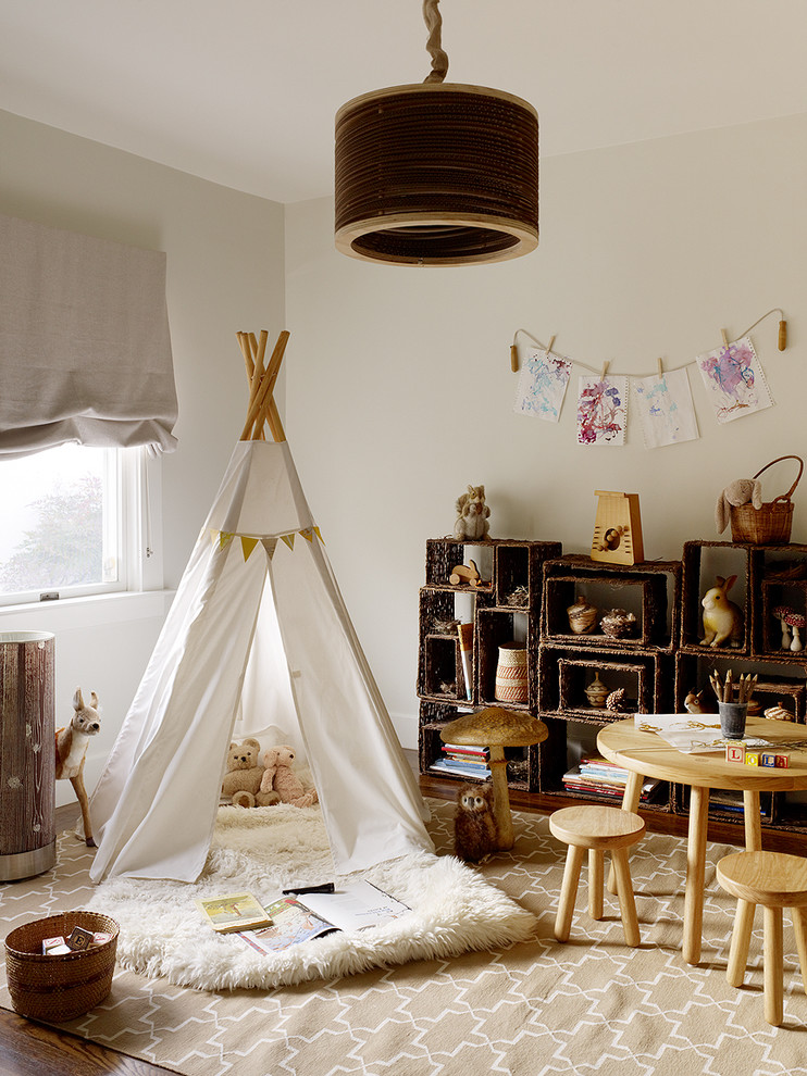Example of a mountain style gender-neutral dark wood floor kids' room design in San Francisco with beige walls