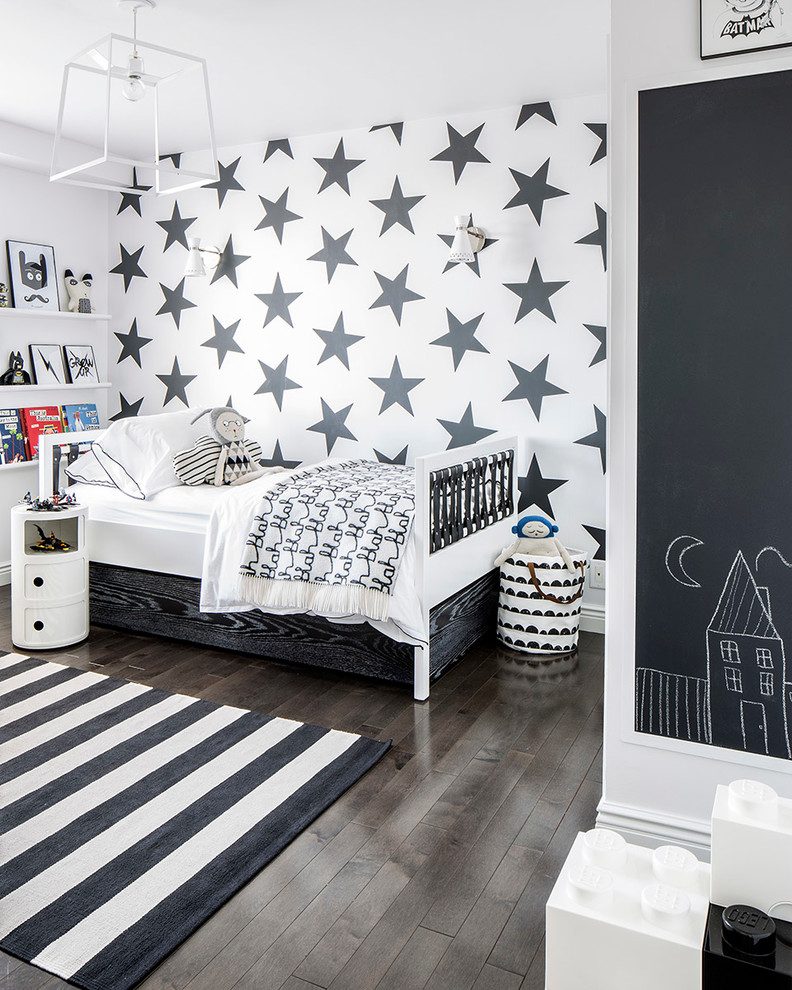Example of a trendy dark wood floor and brown floor kids' room design in New York with multicolored walls