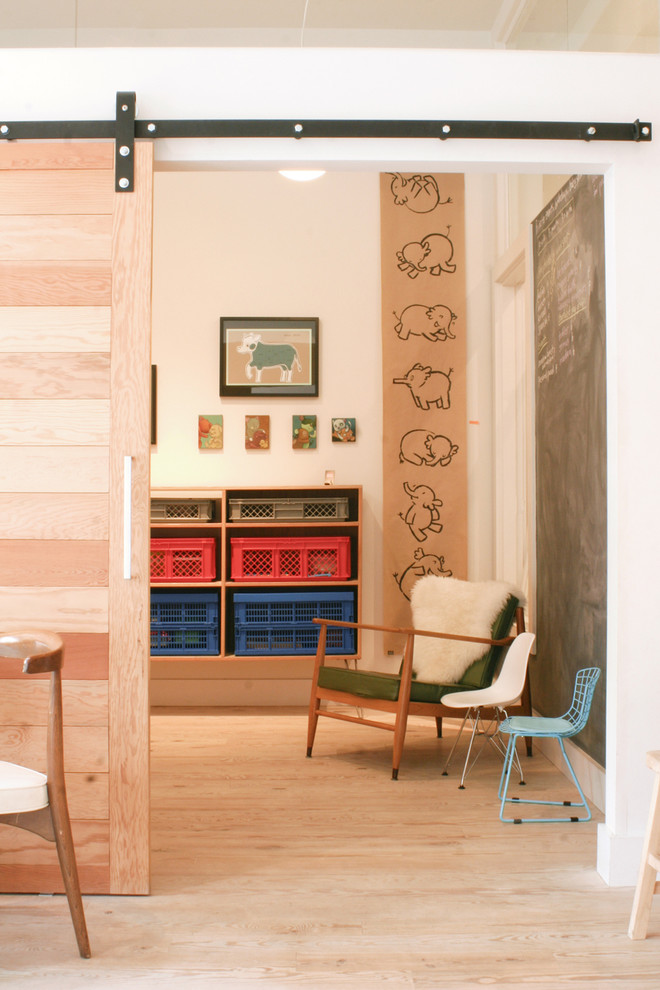 Example of a trendy light wood floor toddler room design in San Francisco