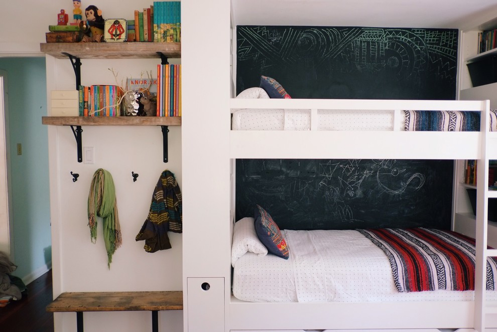 Example of a mid-sized eclectic gender-neutral dark wood floor and brown floor kids' room design in Austin with white walls