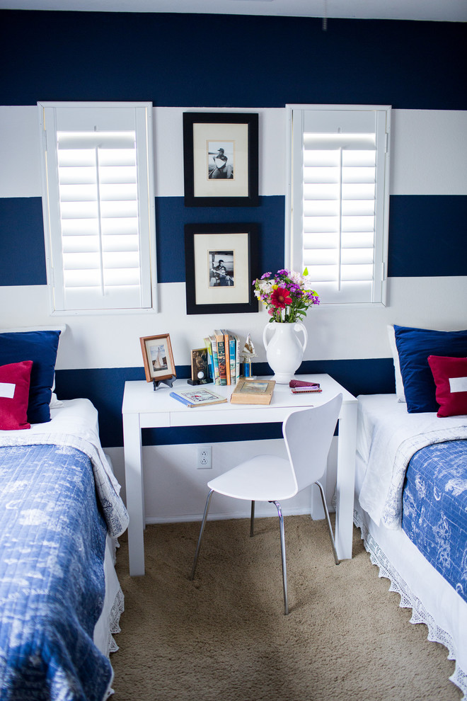 Inspiration for a beach style boy carpeted kids' bedroom remodel in Los Angeles with multicolored walls