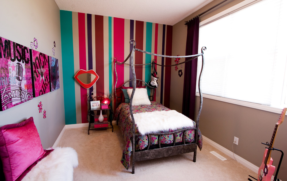 Eclectic girl carpeted kids' room photo in Calgary with multicolored walls