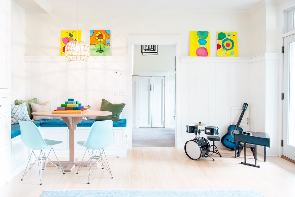 Example of a mid-sized transitional light wood floor kids' room design in Burlington with white walls